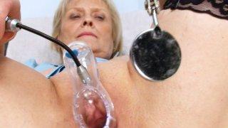 Blonde granny nurse self exam with pussy spreader