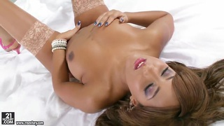 Glamorous young ebony Kayla in stockings teases